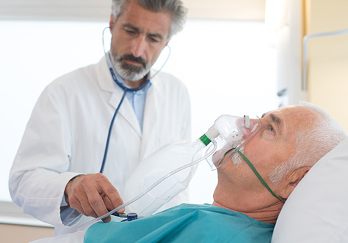 Patient in hospital wearing an non rebreather oxygen mask